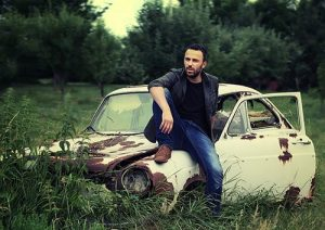 man with scrap car