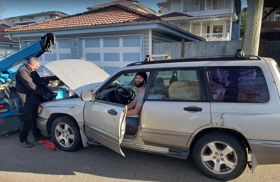 Joe towing a junk car