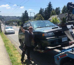 Joe towing Mazda minivan